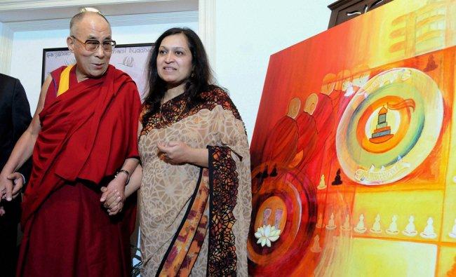 Tibetan sipiritual leader, the Dalai Lama with painter Puneeta Khatri during the inauguration of...