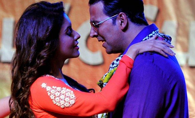 Asin Thottumkal dances with actor Akshay Kumar during a promotional event for Khiladi 786...