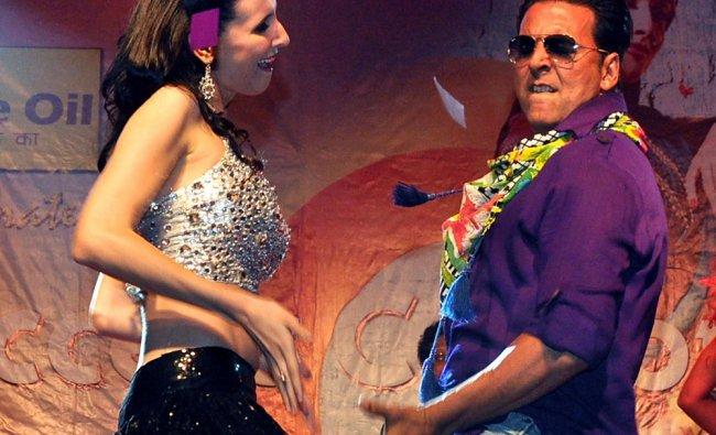 Akshay Kumar dances with German model Claudia Ciesla during a promotional event for Khiladi 786...