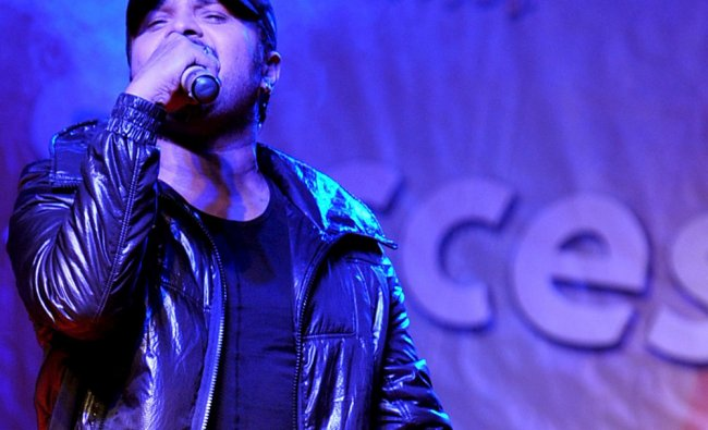 Bollywood entertainer Himesh Reshamiya sings during a promotional event for Khiladi 786...