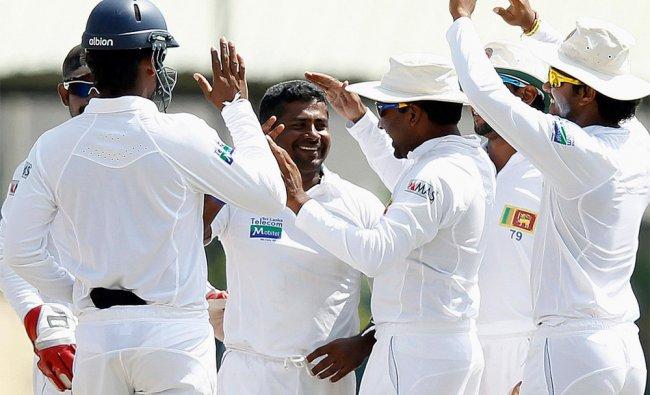 Sri Lanka\'s Rangana Herath celebrates after taking the wicket of New Zealand\'s Kruger van Wyk ...