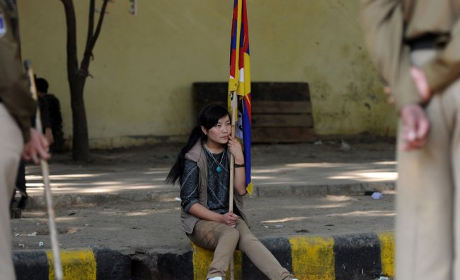 A member of the Tibetan Youth congress holds a flag during a protest in New Delhi...