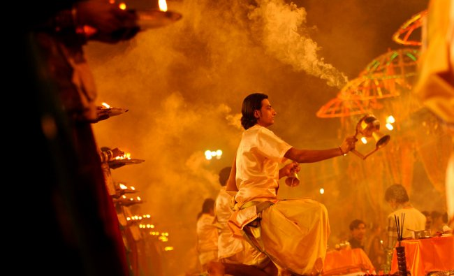 Priests perform rituals during a prayer ceremony dedicated to the Ganges River, holy to Hindus...