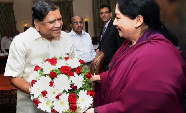 Tamil Nadu Chief Minister J Jayalalithaa is greeted with a bouquet by her Karnataka counterpart...