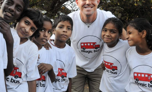 English cricketer Kevin Pietersen with children at an event in Mumbai on Thursday.