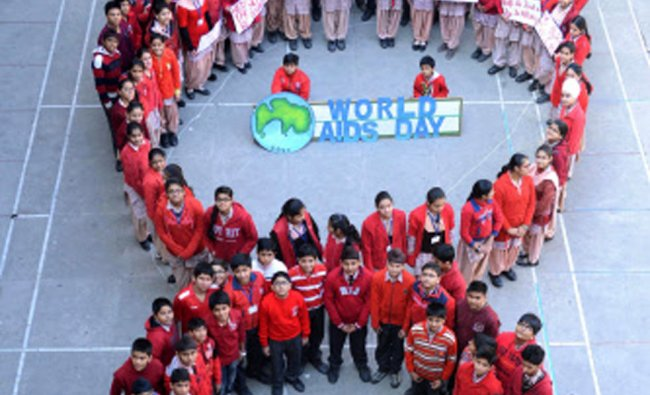 Schoolchildren pose during an AIDS awareness campaign at The DAV Public school in Amritsar...