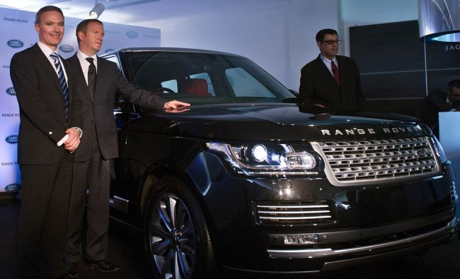 Global Brand Manager Land Rover, Scott Dickens and others pose with newly unveiled Range Rover car..