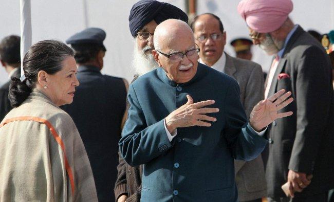 Congress President Sonia Gandhi and senior BJP leader LK Advani during the cremation of former...