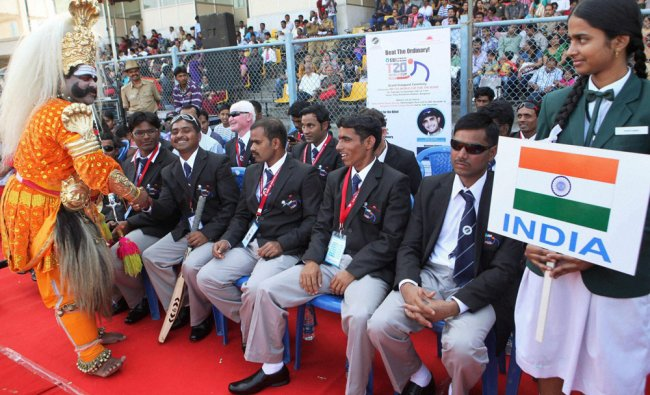 Yakshagana artist greets Indian players during the inaugural ceremony of T20 World Cup for the blind