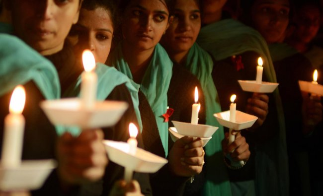 Nursing students hold a candlelight vigil on the occasion of World AIDS Day in Amritsar...