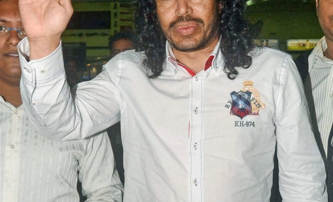 Famous soccer player and former Colombian goal keeper Jose Rene Higuita waves to his fans upon...