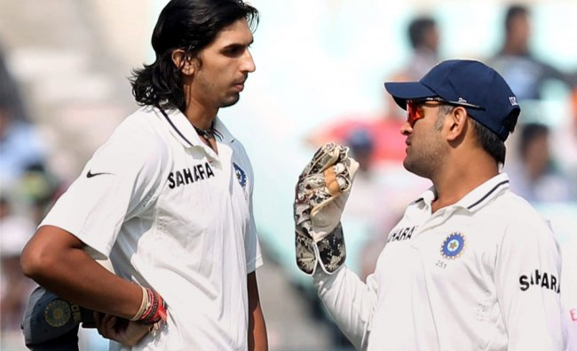 Indian Captain M S Dhoni with teammate Ishant Sharma during Day 2 of the 3rd Test Match against...