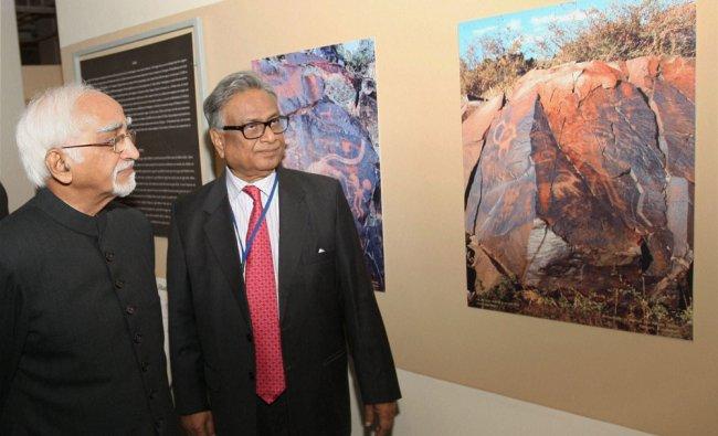 Vice President Hamid Ansari with Chinmaya R. Gharekhan, President, IGNCA Trust, taking a round...