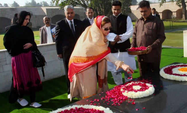 Pakistan\'s Senate Chairman Syed Nayyar Hussain Bukhari with his wife and daughter paying homage...