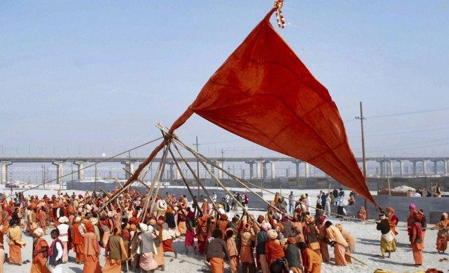 Sadhus take part in the Dharm Dhwaja ceremony ahead of Maha Kumbh festival at Sangam in Allahabad...