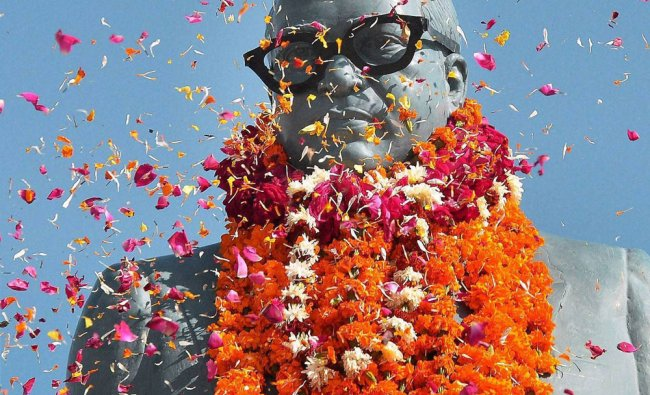 People pay floral tributes to BR Ambedkar on his 57th death aniversery in Bikaner on Thursday.