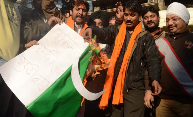Shiv Sena burn a Pakistani flag in protest after a Hindu temple was demolished in Pakistan...