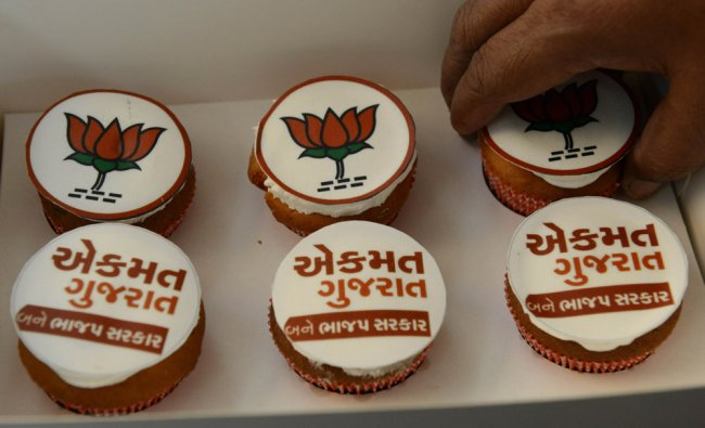 BJP media coordinator arranges cupcakes made by a party supporter at the BJP headquarters ...