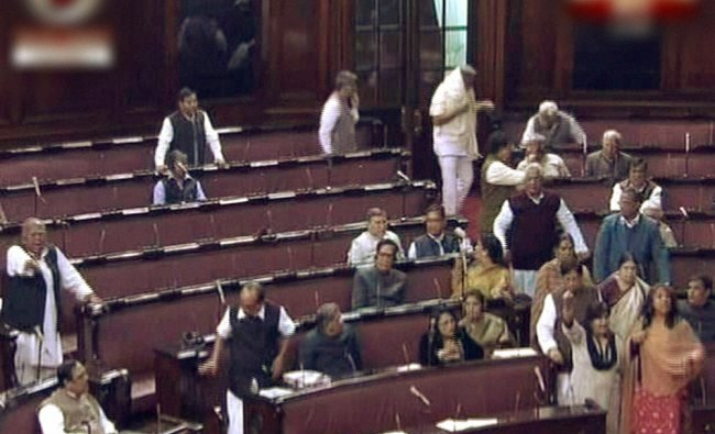 Members during the FDI debate in Rajya Sabha in New Delhi on Thursday...