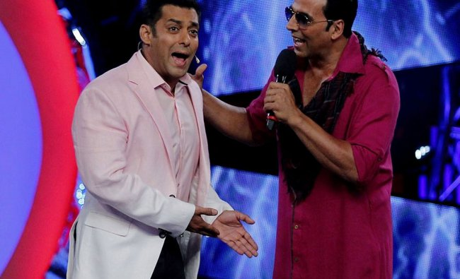 Bollywood actor Salman Khan (L) hosts the Colors television reality show \'Bigg Boss6\' with actor...