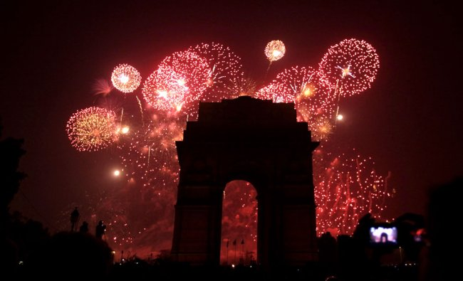 India Gate is silhouetted as fireworks light up the sky above, in New Delhi, on Friday.