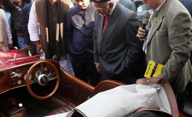Vice President Hamid Ansari having a look of a Vintage car at the car rally in New Delhi...