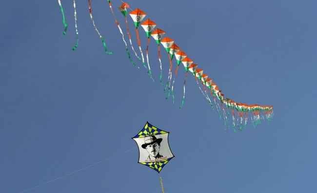A kite displays an image of Bhagat Singh at tha Delhi International Kite Festival...