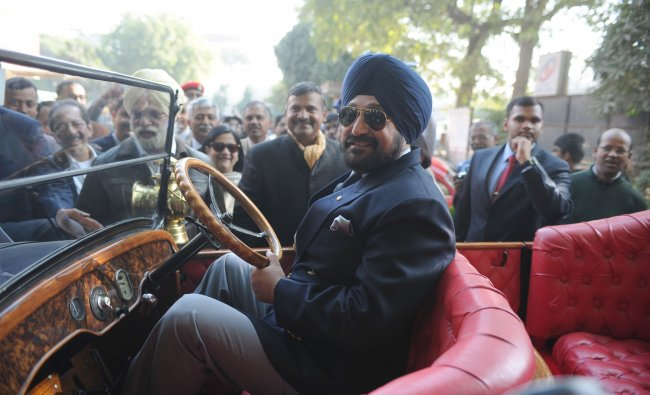 Indian Army Chief Bikram Singh poses in the driver\'s seat of a classic automobile during...