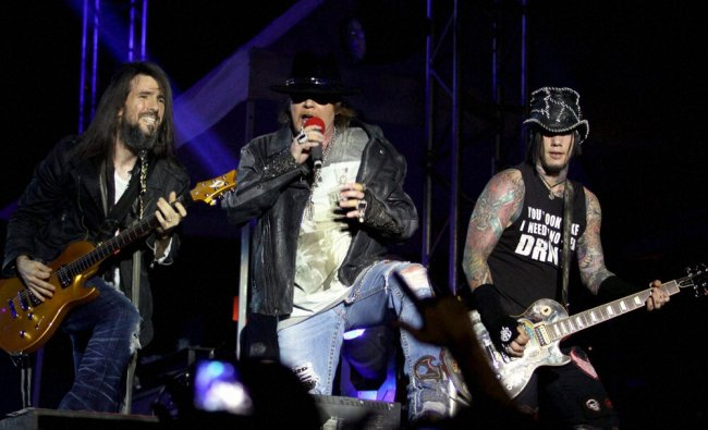 Guitarist Ron \'Bumblefoot\' Thal, Lead Vocalist Axl Rose and DJ Ashba of Guns \'N\' Roses performs...