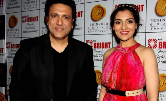 Bollywood actor Govinda (L) with his daughter Narmada attend the Bright Awards in Mumbai...