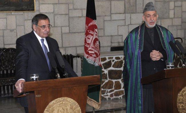 U.S. Defense Secretary Leon Panetta (L) listens as Afghanistan President Hamid Karzai speaks...