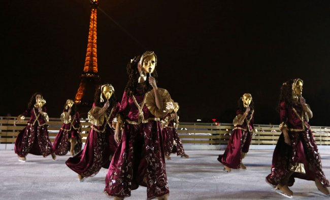 Ice skaters perform dances during the inauguration of the \'Christmas village\', on December...