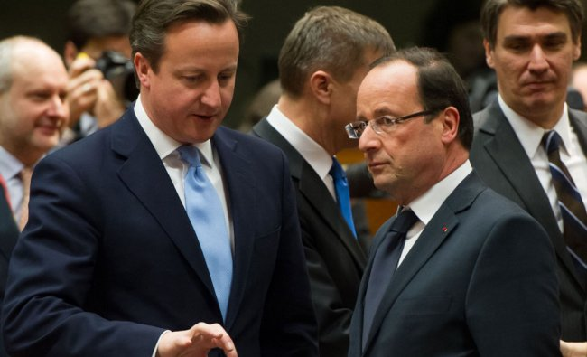 British Prime Minister David Cameron (L) and French President Francois Hollande chat during a...