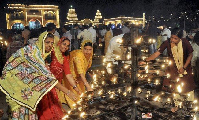 People light oil lamps on the occasion of Kartika utsava celebrations in Hubli at Shri...