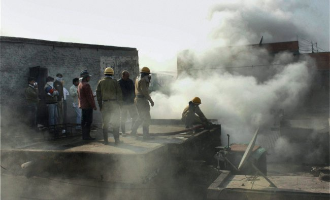 Fire personnel trying to control the fire at Bhagirath Palace in New Delhi on second day...