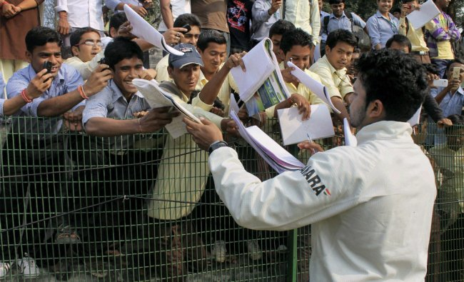 Kerala\'s S Sresanth giving autographs to fans during the Ranji trophy match against Tripura...