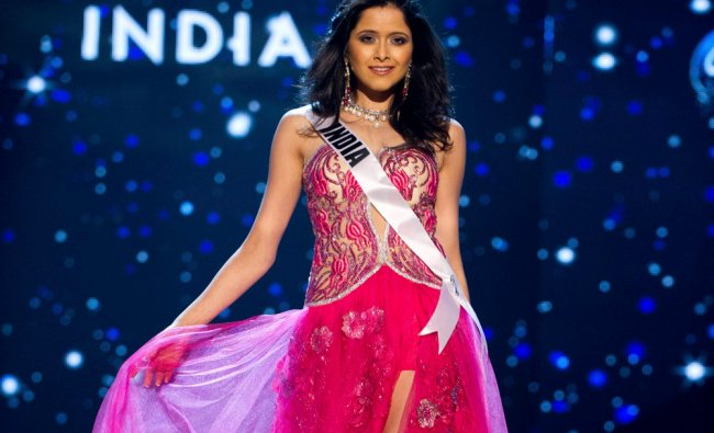 Miss India 2012, Shilpa Singh, competes in an evening gown of her choice during the Evening Gown...