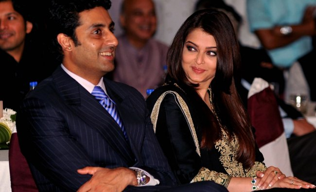Indian Bollywood film actor Abhishek Bachchan (L) and his wife Bollywood film actress...