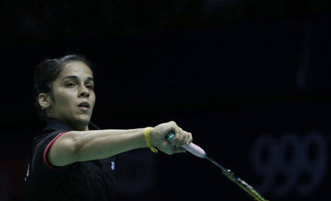 Saina Nehwal of India returns a shot against Juliane Schenk of Germany in the womens singles event