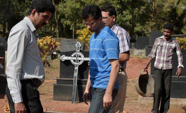 Benedict Barbosa (C), husband of late Indian nurse Jacintha Saldanha, arrives to inspect...