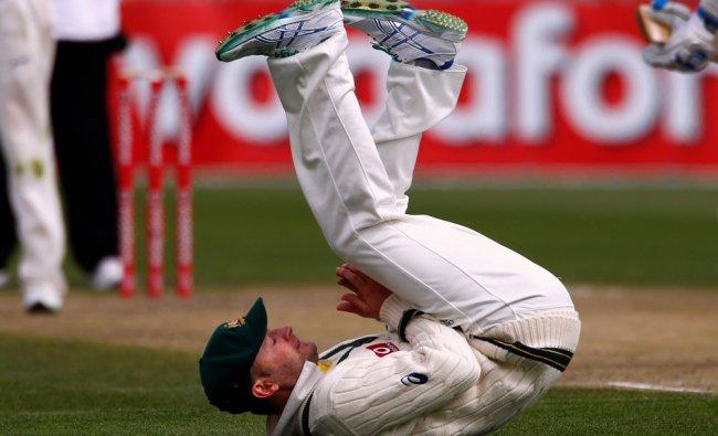 Australia\'s Michael Clarke reacts after dropping a catch from Sri Lanka\'s Kumar Sangakkara...