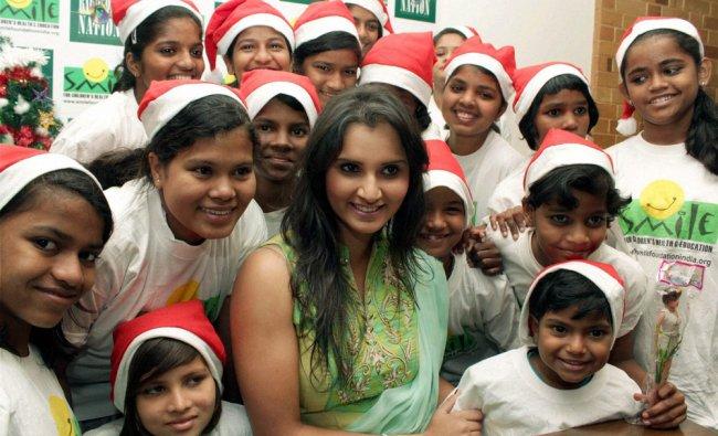 Tennis player Sania Mirza celebrating Christmas with under privileged children in Mumbai on Monday.