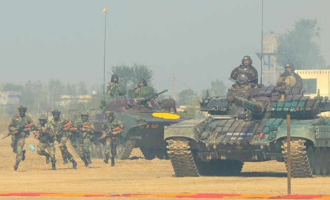 Indian soldiers perform a demonstration drill during an Army Mela and exhibition at Khasa...
