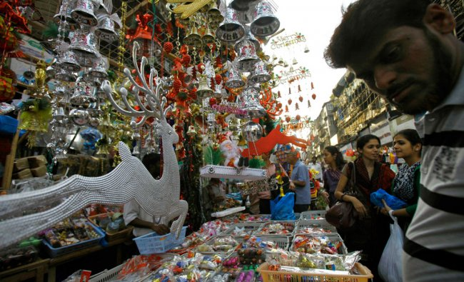 People buy Christmas decorations at a market in Mumbai...