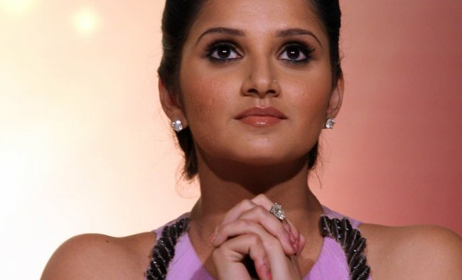 Tennis player Sania Mirza looks on during a promotional event in Mumbai...