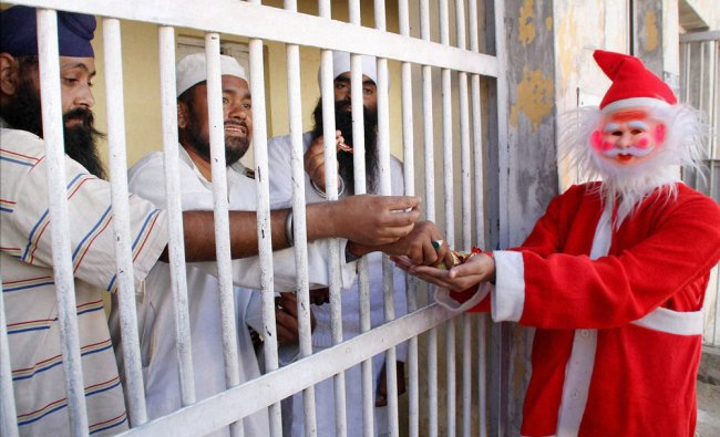 Student dressed up as Santa Claus offering chocolates to prisoners at Kotbhalwal Central Jail ...