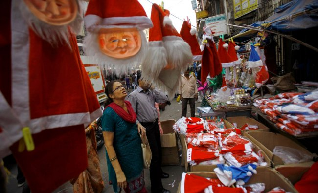 A woman in Mumbai looks at festive hats on sale at a Christmas market...
