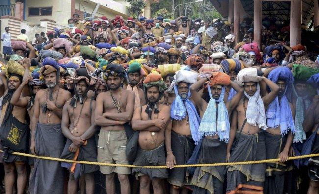 Devotees wait for darshan near Lord Ayyappa Temple in Sabarimala, Kerala ...