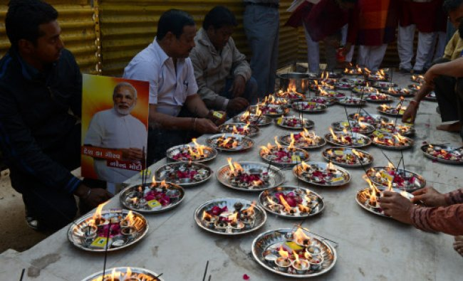 Members of the Gujarat Gaurav Fan Club light oil lamps...