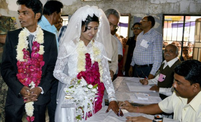 A newly wedded couple before casting votes...